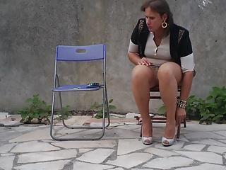 Nadejda smoke an cigarette on her chair …
