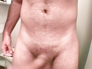 Playing with my big cock in the bathroom