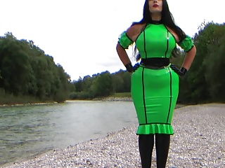 Sexy Busty Babe in green Latex with big tits outdoor