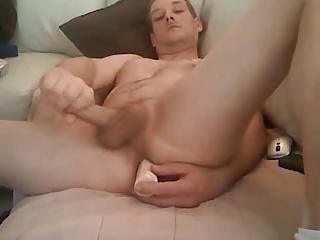 Sexy dude stroking and enjoying a dildo